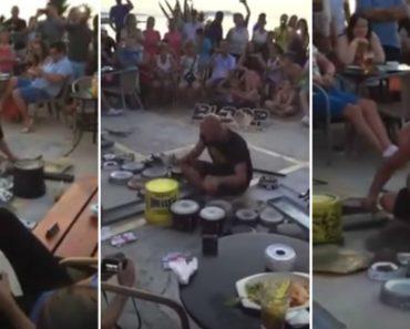 Músico De Rua Atrai Pequena Multidão Com Concerto De Música Eletrónica Usando Vários Objetos 7