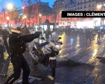 """Polícia Aponta Arma a Manifestantes Durante Protesto Dos """"Coletes Amarelos"""" Em Paris 1"""