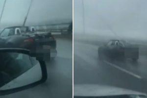Homem Em Descapotável Enfrenta Chuva Violenta Na Ponte Vasco Da Gama 10