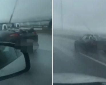 Homem Em Descapotável Enfrenta Chuva Violenta Na Ponte Vasco Da Gama 4
